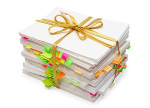 Pack of documents tied up by a gold ribbon